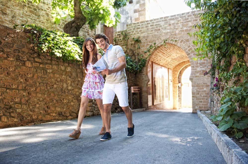 Couple walking by the castle in Denia in Spain